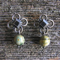 Clare de la Torre Quatrefoil earrings with Rhyolite Tinsmiths